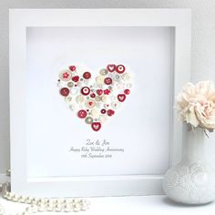 This Personalised Ruby Anniversary Heart artwork makes a gorgeous timeless gift the recipient will treasure forever.We love sourcing our buttons worldwide and take pride in how beautiful each and everyone of them is! You will always get a handpicked mix of our current favourites. Your chosen message and date would be printed underneath the heart in a flowing text. If you would like an old fashioned 'typewriter' style font or something else do mention it when ordering. When choosing the…