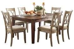 "Series Name:	Mestler Item Name:	Rectangular Dining Room Table Model #:	D540-125 Dimensions:	68""W x 40""D x 30""H Ashley Furniture"