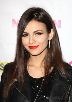 Singer Victoria Justice wore the ultimate rock star beauty look with a winged eyeliner and cherry-red lipstick at the Nylon cover party.