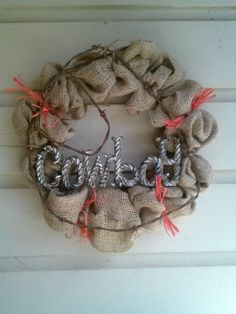 not gonna lie...I kind of love the bailing twine on there.  So much of that in our barn!   Burlap wreath, country wreath, country western wreath