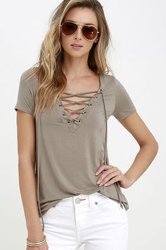 It's time to sit back and slip on the Enjoy the Ride Taupe Lace-Up Top! Super soft jersey knit shapes a lace-up V neckline, threaded through silver grommets, while short sleeves frame the straight-cut bodice.
