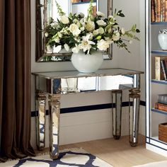 VERSAILLES MIRRORED CONSOLE TABLE, SMALL. Use a table lamp on top of this small console and at night you can enjoy the twinkling reflections from its surface. #oka #mirrored