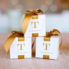 A perennial favor choice, the chocolate truffle, looks fabulous in individual boxes gift-wrapped in your wedding colors and finished off with a mini bow.Photo courtesy of B. Toffee