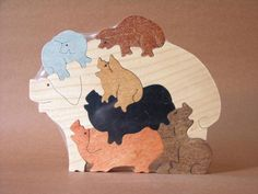 Pile of Pigs Hogs Piglets Farm Puzzle Wooden Toy Hand Cut with Scroll Saw. $13.49, via Etsy.