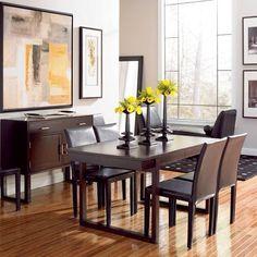 The sharp lines and dark furnishings make for a classy, yet comfortable decor.   (Photo: Draycott Dining Room) #interiordesign #diningroom #decor