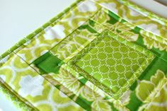 The center square is 4″ and all other strips are 2″ wide. . Start sewing from the center out.  Use a 1/4″ seam allowance when sewing.  As you attach pieces, make sure to iron or finger press the seams toward the outside.  This way your finished top will be smooth.  seam binding.  Cut a strip of fabric 2-1/2″ wide.  You may need to attach a second strip so that the length is long enough to go around the entire potholder. . Iron the strip of fabric in half. Links to binding toutorials included