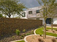 decorative-garden-fence-panels-Garden-fence-with-natural-stone-in-brown
