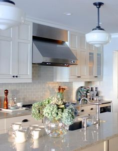 Our soon to be kitchen's theme. White Cabinets, Bianco Romano Granite, Subway Tile Backsplash. Clean and classic.