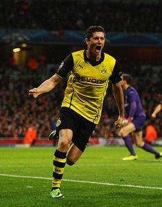 Robert Lewandowski -  striker for the German Bundesliga club Borussia Dortmund and the Polish national team.