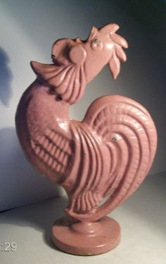 This is Albee - my very own crowing rooster. He is cast iron and has been many colors but is currently pink.