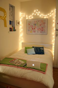 twinkle lights are up in the kids room. simple. and a great night light for them. and festive.