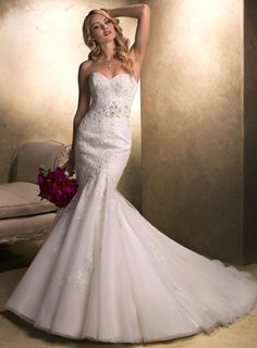 """Designer: Maggie Sottero """"Julia""""    Description: This stunning fit and flare gown with sweetheart neckline features exquisite beaded lace motifs adorning tulle atop Chic Organza and Delustered Satin. Finished with corset back closure and available with detachable floral belt glistening with Swarovski crystals. $1495.00"""