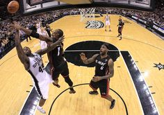 Chris Bosh Forward DeJuan Blair #45 of the San Antonio Spurs takes a shot against Chris Bosh #1 of the Miami Heat at AT Center on March 4, 2011 in San Antonio, Texas.