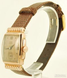 """Ending tomorrow on eBay are discounted listings for a variety of our vintage & modern items; included in the sale is this Elgin DeLuxe wrist watch, with a rose-toned metal dial, a 17-jewel movement, & a rose gold (filled) case with stepped sides & scalloped cylindrical lugs.    To take a look at all of these pieces on sale, visit our """"On Special This Week"""" page here...  http://stores.ebay.com/PM-Time-Service/On-Special-This-Week-/_i.html?_fsub=6"""