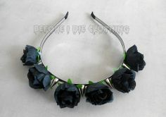 Headband handmade metal, covered with a black ribbon, decorated with spikes and fabric flowers Each headband has 6 flowers and 5 spikes Medium width flowers : 3cm Spikes Height : 2.5 cm