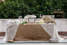 Wedding welcome table with burlap and lace.