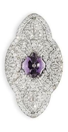 CARTIER - AN ART DECO AMETHYST AND DIAMOND BROOCH. Of foliage design, the quadripartite brooch pierced and pavé-set with circular-cut diamonds centring upon a textured amethyst cabochon, mounted in platinum, signed Cartier Paris, length 6.50 cm. #Cartier #ArtDeco #brooch