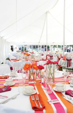 Like----Hot pink, hot orange and turquoise are the 'hot' colors taking the stage for many weddings this season. When set against a white backdrop, the effect is vibrant and inviting.