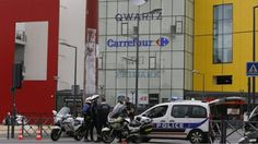 Welcome to NewsDirect411: Breaking News: Armed Men Attack Shopping Centre Ne...