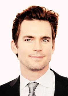 50 shades--- its' all about Matt Bomer fb page  Copper hair and gray tie.
