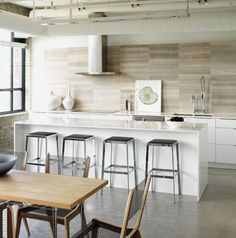 Like everything. Color scheme, tiles against wall, clean lines of island, color of island, light bank over the island. Wooden furniture, floors. This is exactly what we would like. Love the wood, stainless steel and organic white caesar stone. Would like a little bit more wood.