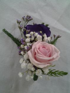 Pink rose,lisianthus and gip button hole