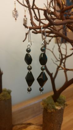 Hey, I found this really awesome Etsy listing at https://www.etsy.com/listing/173559280/black-and-silver-beaded-earrings