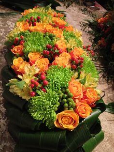 Yes, this is a coffin arrangement for a funeral, but I really like these particular colors, shapes and textures together. Funeral Flower Arrangements, Funeral Flowers, Alter Flowers, Spring Flowers, Casket Flowers, Funeral Sprays, Casket Sprays, Cemetery Flowers, Sympathy Flowers