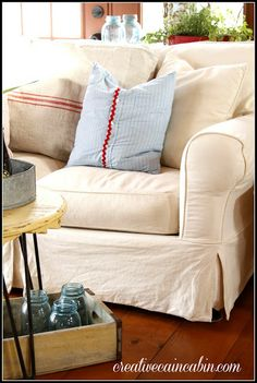 Living Room with White Slipcovered Furniture - Creative Cain Cabin
