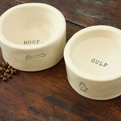 Two handmade ceramic dog bowls are playfully illustrated with a bone or fire hydrant and hand stamped with the words Woof or Gulp inside. Bowls each measure 7 in diameter and 3 1/2 in height and the set comes gift wrapped in a hand crafted wood crate with ribbon.