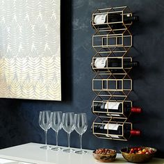Contemporary Wall Mounted Metal Wine Rack Installed In The Black Walls