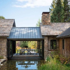 love the metal roof, little open covered patio would be a great way to join the main house and pop's cottage