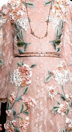 This is a haute couture evening gown by Valentino. In today's prices, a gown with this much hand work in it would cost $150,000 or more. So feel proud of the hand sewing skills you have and enjoy the journey of improving them and trying new forms of embellishment!