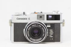 Canodate E 1970 - this camera pioneered the auto dating feature.  For focusing, the camera had a double-image superimposing rangefinder. The viewfinder frame lines indicated the position of the imprinted date. The viewfinder also had a combination battery check and camera shake warning indicator, and flash indicator.