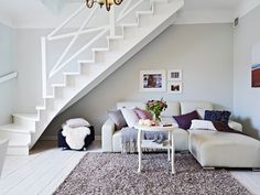 laundry under staircase | Fill in the space under stairs with a cozy nook-like seating area ...