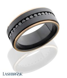 This sleek ring is made of Zirconium, edged with 14 carat Rose Gold with 16 black diamonds in a channel setting. Lashbrookdesigns.com