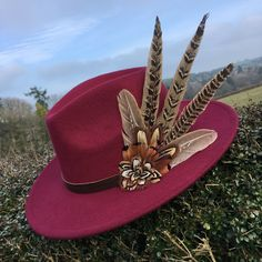 6d99337b4c956 Burgundy fedora hand embellished with natural game bird feathers.  Fascinator Hats ...