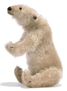 A SMALL STEIFF POLAR BEAR, (8320?), jointed, mohair, black boot button eyes, black stitching, ball-jointed neck and FF button, circa 1910 --8in. (20cm.) long (some slight thinning, a few small holes to pads)
