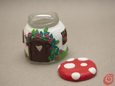 Our mushroom candle DIY is just un'amanita.  cute little fairy house, baby food jar, recycle small jar, storage