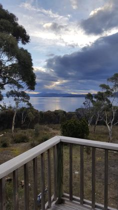 Te Kuiti is a smartly furnished 2 level holiday home set in Australian bushland with panoramic views of the D'Entrecasteaux Channel and the Tasmanian coast. Bruny Island, Holiday Accommodation, Tasmania, Outdoor Dining, Vacations, Cottage, Sunset, Amazing, Garden