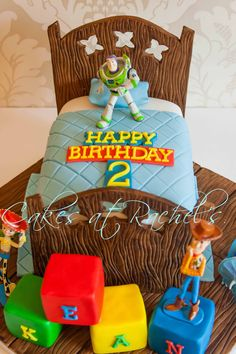 Toy Story Cake - Toy Story cake for a special little boys second birthday :) I especially loved making the hand painted wooden elements of this cake :)