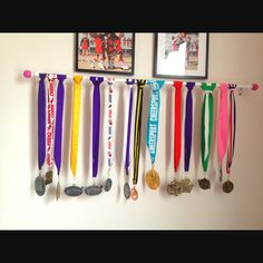 We have Morgan's medals from cheer leading hung on a curtain rod so you can see them all :)