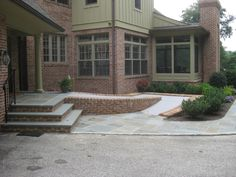 Flagstone and Brick steps and heated handicap ramp.