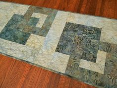 Hey, I found this really awesome Etsy listing at https://www.etsy.com/listing/533075888/quilted-modern-batik-table-runner-in