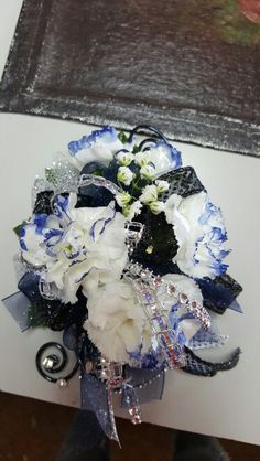 White mini carnation wrist corsage with black silver and navy blue accents