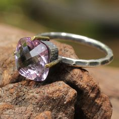 Amethyst cocktail ring with sterling silver textured and oxidized band for an antique look. Bezel and prong set purple amethyst gemstone.  Designed by Sirilak Samanasak.  http://sirilaksamanasak.com