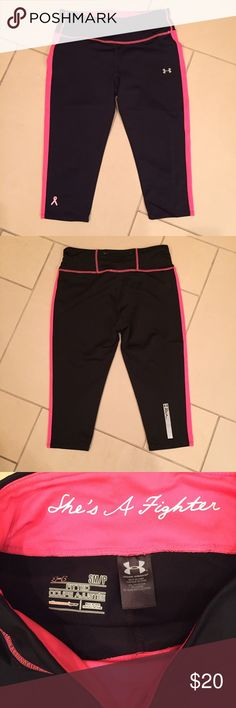 """Under Armour Dri-Fit Capris Under Armour Dri-Fit Capris are from the breast cancer awareness line. Zipper pocket located in the back waistline. Shorter style with a 16"""" inseam. Good condition! Under Armour Pants Leggings"""