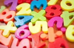 Closeup of colourful plastic toy numbers and symbols for teaching kindergarten children basic mathematics - free stock photo from www.freeimages.co.uk
