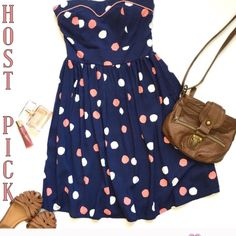 "Strapless Polka Dot Mini/Summer Dress  Navy blue with coral/pink and white polka dots.  Sweetheart neckline with coral/pink piping detail.  Upper back has elastic stretch and a 10"" zipper. Upper half of dress is lined. 100% Rayon  Measurements (laying flat) 26"" length  13"" waist  Perfect condition - not sure on the brand, my daughter cut the tag out.   Feel free to ask if you have any questions Dresses Strapless"