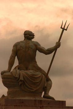 Very humanized sculpture. It uses great detail, focusing on the curves of the muscular body. It looks like King Triton from the back as he wields his spear.